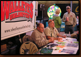 Delbert Stover, Dennis Dunlap and Denny Bohls work the booth at the 2009 Rapid City Sports Show.