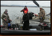 Tournament anglers (left and right in camo) bring fish in to be measured at the 2009 Black Hills Anglers Catch and Release tournament. SDWU volunteers Mike Johnson (orange stocking cap), Brenda Johnson (SDWU ballcap) and Nancy Smidt (red guidewear) worked the official's boat.
