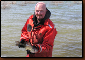 Mike Johnson with a tagged walleye just prior to releasing it.