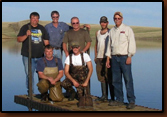 Volunteers that assisted in placing the dock at Waggoner Lake. Far right is Denny Bohls, project coordinator for the Rapid City Chapter. Agencies that helped make this possible include the Philip PD, Philip VFD, Haakon County Highway Department, SD GF&P and SDWU.