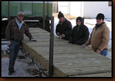 Denny Bohls, Ken Edel, Brenda Johnson and Dan Amen admire the new decking on the dock project.