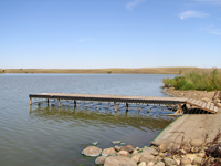 View of the Boat Ramp and Dock at Curlew Dam looking East.