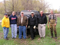 Nancy Smidt, Brenda Johnson, Denny Dunlap, Denny Bohls, Delbert Stover and Gary Miller stand behind the pick-up truck of trash collected at the Rapid Creek Cleanup.