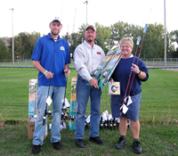 Aaron Holland of SDSU accepts the 42 new rods/reels donated by the Rapid City Chapter of SDWU.