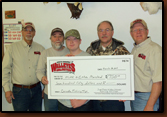 The winners of our of the Tobin lake fishing trip we gave away at our last banquet. Larry Jobe (the winner. gray beard) gave the trip to Mike and Ethan Marsland the night of our banquet. Denny Bohls and Lee Jensen is presenting a check for $750.00 to help cover expenses on their trip.