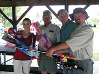 Alison Lessard (EAFB Commercial Sponsorship Coordinator) accepts 6 rod/reel combos from RCAC at the 'Party at the Lake'. Members shown from left to right: Ray Barck, Lee Jensen and Michael Johnson. Not shown - Loren Kasuske.
