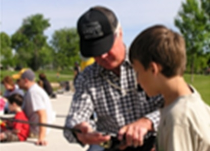 Older Gentleman teaching a younger man how to fish